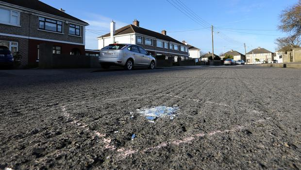 Evidence mark surrounds broken glass at the scene of a hit and run on Hazelwood Drive, Kilmore, Coolock (Image: Frank Mc Grath)