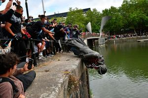 Protesters throw statue of Edward Colston into Bristol harbour  Photo credit: Ben Birchall/PA Wire