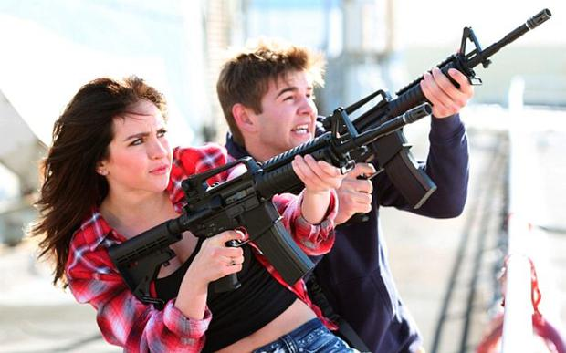 """Ryan Newman as Claudia Shepard, left, and Jack Griffo as Billy appear in a scene from """"Sharknado 3: Oh Hell No!"""""""