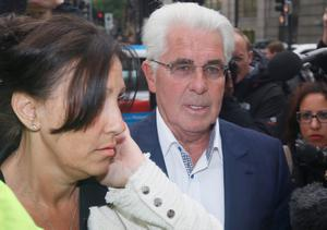 Publicist Max Clifford arrives at Westminster Magistrates Court with his wife Jo, in London