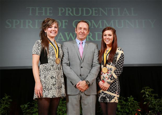 Orla Jackman (15), left, of Tullow, Co Carlow and Leigha Coade (17), from Armagh, with Hollywood star Kevin Spacey in Washington DC