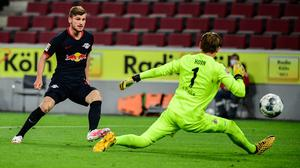 HITMAN: Leipzig's Timo Werner, left, scores his side third goal past Cologne keeper Timo Horn. Photo: Ina Fassbender/Pool via AP