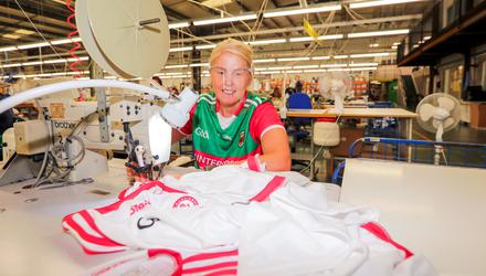 Team player: Sharon Donnell dons a Mayo jersey while making Tyrone jerseys in the O'Neills factory, Strabane. She makes up to 1,000 jerseys a day.
