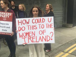 People gather to protest against plans to allow Sisters of Charity to own new National Maternity Hospital