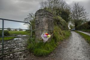 Flowers placed at the entrance to the O'Sullivan family farm at Assolas, near Kanturk, North Cork. Photo: Daragh Mc Sweeney/Provision