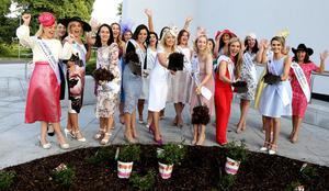 Rose of Tralee contestants, including Kildare Rose Grainne Carr (centre in white dress), take part in a rose-planting ceremony yesterday. Photo: Aishling Conway