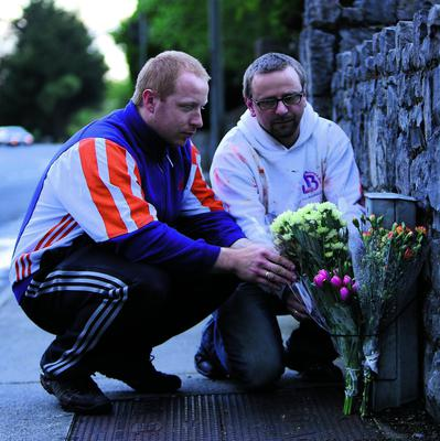 16 May 2013 Story Barry Duggan  Bart and Jack friends of Tom Nowakowski lay flowers near the spot where Tom died on Tobertscain road in Ennis quite close to his home.  Picture Press 22