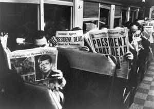 Commuters reading of John F. Kennedy's assassination, 22nd November 1963.  (Photo by Carl Mydans/The LIFE Picture Collection/Getty Images)