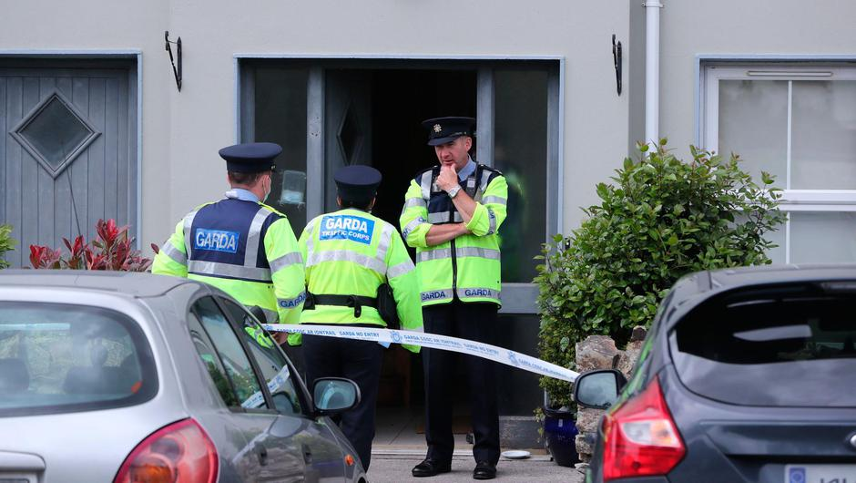 Gardaí at the house in Clashmore, Co Waterford, where Mia O'Connell died. PA