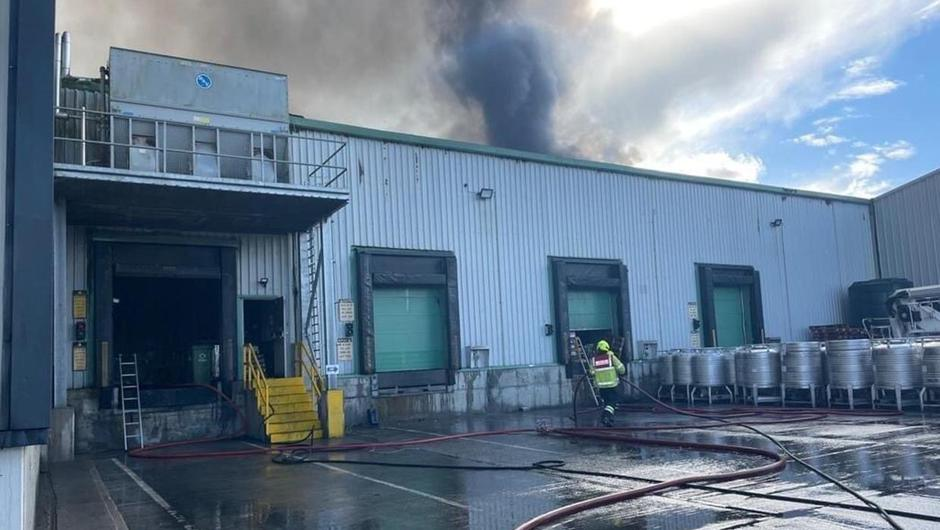 A photo of emergency services tackling the blaze at the Glenisk plant. Photo: Offaly County Council.