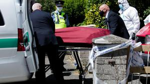 The remains of Harry Sheeran being removed from the house on Carriglea View, Firhouse, Dublin. Photo: Gareth Chaney/Collins