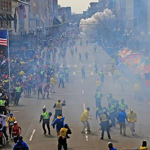 People react as an explosion goes off near the finish line of the Boston Marathon (AP)