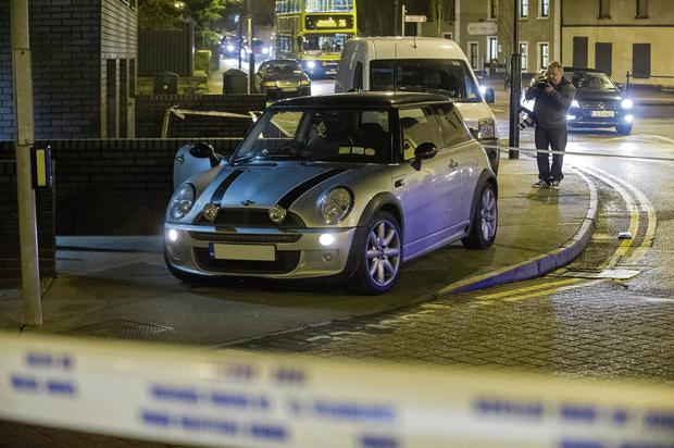 The silver Mini Cooper car left outside the garda station in Clondalkin village after last night's shooting.