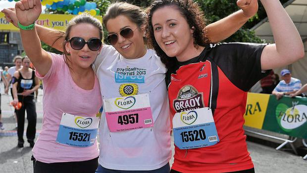 3 June 2013; Sophie Fleming, left, Rebecca O'Toole and Lorna Merrins, all from Nurney, Co. Kildare, celebrate finishing the Flora Women's Mini Marathon 2013. St. Stephen's Green, Dublin. Picture credit: Barry Cregg / SPORTSFILE