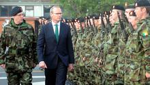 Defence Minister Simon Coveney reviews the personnel of the 46th Infantry Group at Costume Barracks, Athlone. Photo: James Flynn/APX.