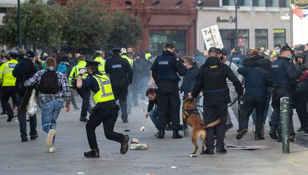Protesters and gardaí clash during an anti-lockdown protest in Dublin city centre on Saturday. Photo: PA
