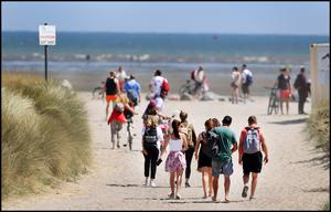 Scorching: People enjoy fine weather on Dollymount Strand in Dublin as the prolonged dry spell continues. Photo: Steve Humphreys
