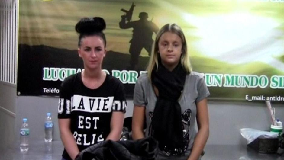 Michaella McCollum (left) and Melissa Reid are questioned by police in Lima, Peru, in this still image taken from video provided by the police in August, 2013.