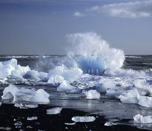 Iceberg being broken by the waves