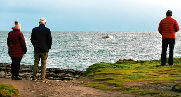 A fishing trawler searches while taking part in the search for the missing fisherman off Hook Lighthouse in Co Wexford.