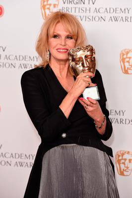 Joanna Lumley, winner of the Fellowship Award, poses in the Winner's room at the Virgin TV BAFTA Television Awards at The Royal Festival Hall in London, England. Photo: GETTY