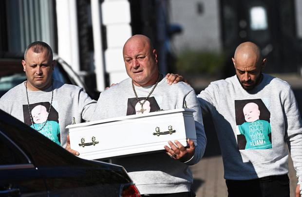 Liam O'Keefe carries his son's coffin from Brown's Funeral Home on the Oldpark Road before heading on towards Roselawn Crematorium. Photo by Pacemaker