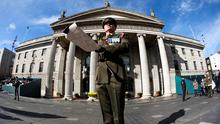 Captain Peter Kelleher from the 27th Infantry Battalion reads the Proclamation at the GPO on O'Connell Street on March 27, 2016 in Dublin