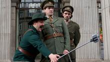 Seán Purcell (Peter Coonan) taking a selfie of himself, Owen McDonnell (Ernest Timmons) and Tom Morgan (Seán T Ó Meallaigh) outside the GPO in 'Wrecking The Rising'.