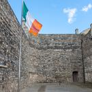 The Irish flag flies in the Kilmainham Jail yard, where some of the 1916 leaders were executed.