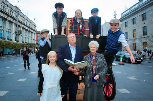 Broadcaster Joe Duffy and his mother Mabel with children dressed in 1916 costume at the launch of his book on O'Connell Street in Dublin