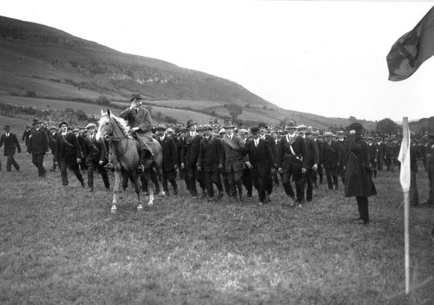 A mounted National Volunteer saluting the flag during a drill at Keash, County Sligo. The Irish National Volunteers objected to Irish involvement on the British side in the war against Germany. (Photo by Central Press/Getty Images)