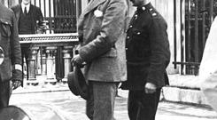 Roger Casement (1864 - 1916) is escorted to the gallows of Pentonville Prison, London. He was charged and found guilty of treason after trying to obtain German aid for Irish Independence