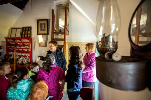 Tour guide Paul Gibson with pupils from Kiltyclogher National School, visiting the the birth place of Sean MacDiarmada in Kiltyclogher, Co. Leitrim.