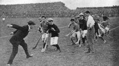 Michael Collins throws the ball in at Croke Park.