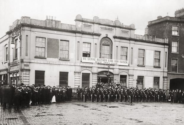 Before: Members of the Irish Citizen Army outside Liberty Hall shortly before the Easter uprising. Photo: FPG/Hulton Archive/Getty Images