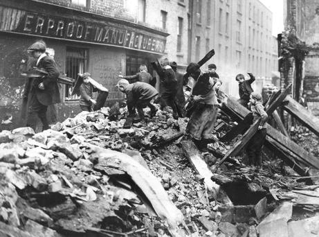 Searching the rubble: Dublin children collecting firewood from the ruined buildings damaged in the Easter Rising.