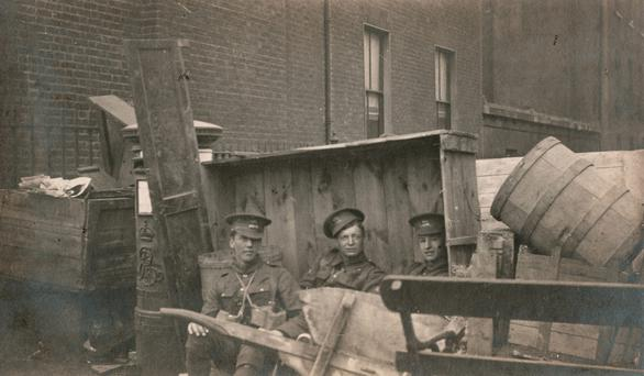 A barricade made from barrels, 1916 © Sean Sexton Collection, courtesy of the Sean Sexton Collection