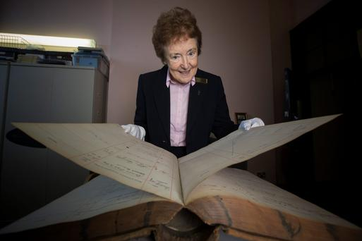 Archivist Sister Euugene Nolan with some of the records from 1916 held at the Mater Hospital in Dublin. Pic: Mark Condren