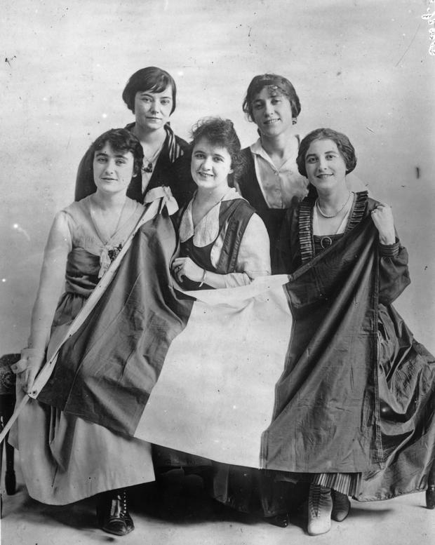 Female Irish Republican supporters pose for a photograph with an Irish tricolour to publicise a meeting in mid-1916. (Photo by Topical Press Agency/Getty Images)