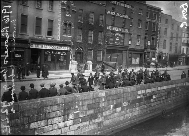 Dead men walking: Prisoners being marched to barracks in 1916. (Part of the NPA/Independent Collection)