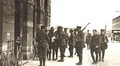 Michael O'Hanrahan being escorted into his court-martial, Richmond Barracks, 3 May 1916.