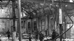 Soldiers inspect the interior of Dublin's General Post Office, viewing the complete destruction of the building after being shelled by the British during the Easter Rising 1916.