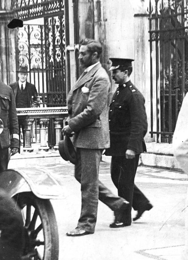 Roger Casement is escorted to the gallows of Pentonville Prison, London after being found guilty of treason.