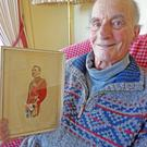 Proud: Arthur French with a photo of his grandfather, Colonel George Arthur French - 'I'm enormously proud of him because he saved bloodshed in Enniscorthy'