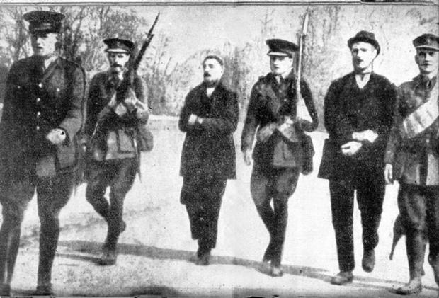 Thomas Kent on the left and William Kent being led across Fermoy Bridge in May 1916.