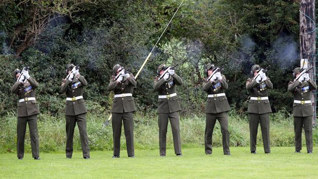 Irish soldiers fire a volley of shots in honour of Thomas Kent, one of 16 men executed following the 1916 Easter Rising