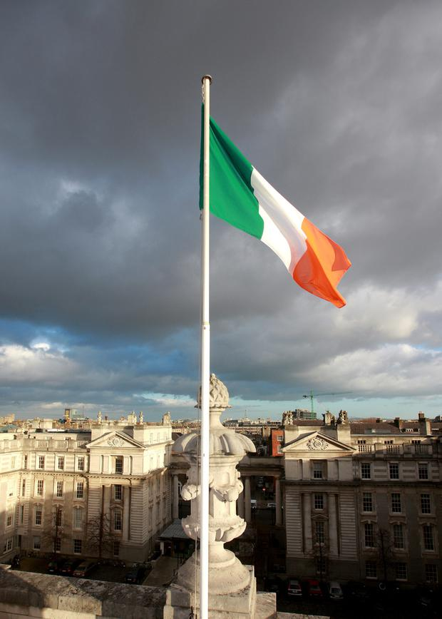 The Irish flag flies over Government Buildings.