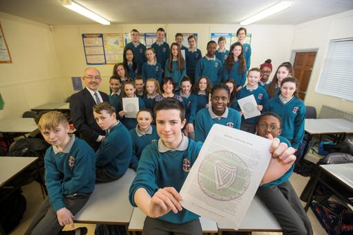 First year student Ross Devine and class who have helped draw up the school's Proclamation for a New Generation at Hartstown Community School , Dublin 15. included are Principal, John Bean and teacher Siobhan Daly. Photograph: Mark Condren