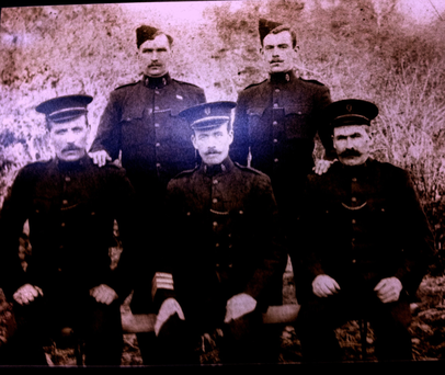 FAMILY HISTORY: Fergal's great-grandfather, sergeant Paddy Hassett of the Royal Irish Constabulary, seen sitting in the front, middle. His son Paddy, Fergal's grandfather, would later join the IRA during the War Of Independence, radicalised by the aftermath of the Easter Rising