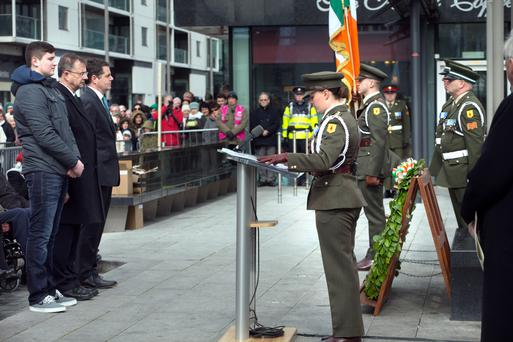 Shane Dunne Colclough, great grandson of John Dunne, Eamon O Cuiv, grandson of Eamon de Valera and Acting Minister for Transport Pascal Donohoe at the 1916 Bolands Mill wreath-laying ceremony at Grand Canal Dock Photo: Tony Gavin